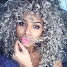 A gorgeous grey shows there is no shame in having a few grey hairs. | 15 Gorgeous Photos That Prove Natural Hair Looks Great In Any Color