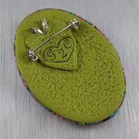 example back of a combination brooch-pendant