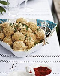 Hungarian Potato Dumplings Recipe on Food & Wine----Still warm baked potatoes are riced then mixed with egg yolk, seasoning and flour to form a dough that is shaped and simmered in salt water. Healthy Soup Recipes, Meat Recipes, Wine Recipes, Cooking Recipes, Hungarian Cuisine, Hungarian Recipes, Hungarian Food, Potato Dumpling Recipe, Food & Wine Magazine