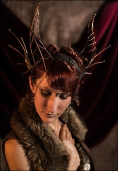 Hey, I found this really awesome Etsy listing at https://www.etsy.com/listing/187750798/elegant-maleficent-dragon-horned-crown