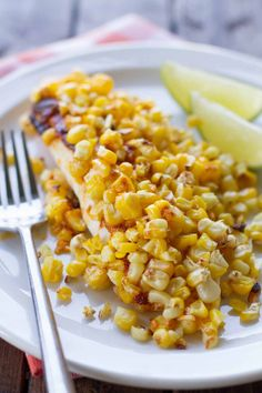 Tilapia is covered with a slightly spicy sauce that keeps it nice and moist with roasted corn on top for an amazingly easy summer supper. You can also use frozen corn and serve this year round! Fish Dishes, Seafood Dishes, Fish And Seafood, Seafood Recipes, Cooking Recipes, Main Dishes, Tilapia Recipes, Cooking Ideas, Easy Fish Recipes