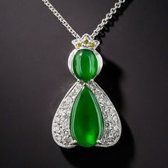 Natural Burma Jadeite Pendant!  Assumed to be a late 20th century piece from Hong Kong!   Item# 90-1-10113  In my imagination it kind of looks like Princess Daisy from Mario Brothers