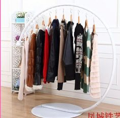 Wrought iron clothes hangers, wrought iron clothes rack, clothing store hanger landing shelf display rack clothing store island -in Storage . Cheap Clothes Rack, Clothes Hangers, White Hangers, How To Iron Clothes, Display Shelves, Display Ideas, Wrought Iron, New Outfits, Shopping