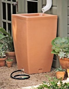 Santa Fe Rain Barrel - reuse the rain water, very cool! Rain Water Barrel, Rain Barrel Stand, Rain Barrel System, Rain Barrels, Hose Hanger, Santa Fe Style, Water Collection, Garden Supplies, Lawn And Garden