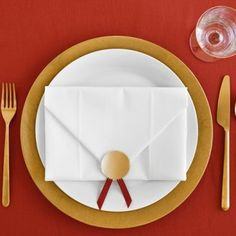 Envelope napkins. The original blog has been removed but it must be fairly easy...be fun to do with gold organza