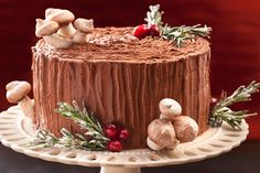This version of the Christmas yule log, or bûche de Noël, has devil's food cake layers, a cherry–whipped cream filling, and bittersweet chocolate frosting.