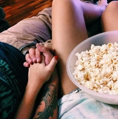 Watching movies with popcorn and hotsauce