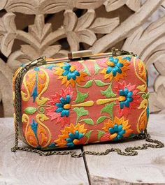 coral silk clutch with multi-colour thread embroidery by Karieshma Sarnaa