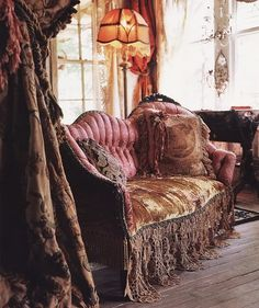 satin rose colored victorian couch, velvet throw with crocheted tassels.  lamp  shade with fringe.  Brocade curtain room divider  ..   http://www.magnoliapearl.com/
