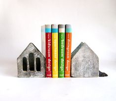 Small minimalist bookends.  Tin houses made from very strong clay with grog and fired for two times about 1250 C. You can use the house as a pencil holder