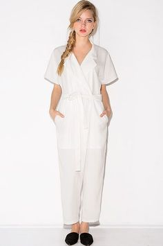 """18 Jumpsuits You Can Totally Wear To The Office #refinery29  http://www.refinery29.com/how-to-wear-jumpsuits-in-office#slide-12  A lightweight, woven, white jumpsuit screams """"summer"""" (even though your morning coffee run just got so much more stressful.) ..."""