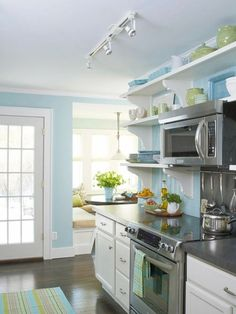 Colors for upstairs :   Kitchen - blue walls with tan and green accents  Dining room - green walls with tan and blue accents  Living room and hallways tan with green and blue accents   All with white trim!   <3