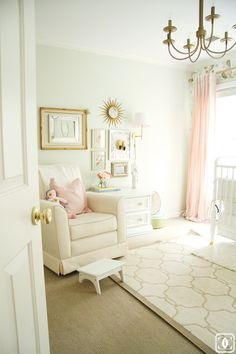 a pretty palette of coral & mint florals, brass & ivory in this sweet nursery