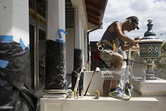 A worker paints a vase as renovations start at the Hotel Herrera in the historic district of Casco Viejo in Panama City, Panama, on Tuesday, April 6, 2016. Tax revenue grew to $1.3b, a 19% increase over 1Q last year, the Ministry of Economy and Finance said in a statement. Photographer: Susana Gonzalez/Bloomberg via Getty Images