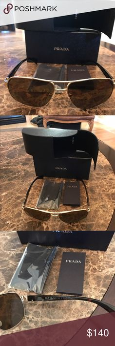 Prada Sunglasses. These are a great pair of Prada Sunglasses. Case, Box and never opened cleaning cloth. Prada Accessories Sunglasses