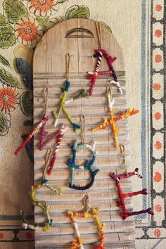 branch letters. Hot glue in advance? Or with kids? Have kids wrap them with pipe cleaners or yarn...
