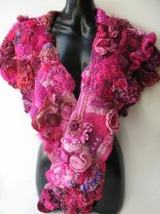 A freeform crochet shawl in deep tones of pink from Prudence Mapstone's Pink Project