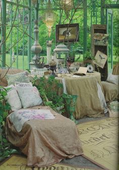 You can buy and assemble this ornate Victorian-style glass and iron conservatory and have it for your own....click thru view all the photos.....its awesome.