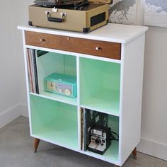 This vintage style cabinet went from shabby to chic, check out the before and after photos and the multiple uses for this fun cabinet.