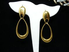 Holiday 2015 Sale - Marked Down 20% ! #GiftIdeas Holiday Sale!!!  Monet Teardrop Dangling Earrings - Goldtone Modern Rhinestone Clip on's - Designer Signed Retro 1990's offered by #TheJewelSeeker on Etsy  Style:  Classic b... #vintage #jewelry #teamlove #etsyretwt #ecochic #thejewelseeker