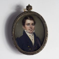 """Nathaniel Rogers (American 1787-1844). Portrait Miniature of a Gentleman in Black Coat Wearing a Stick Pin - Watercolor on ivory, 2 3/4 inches. Signed """"N. Rogers M.Y."""" l.r. In a pendant case with cast foliate border, the reverse with aperture displaying plaited hair."""