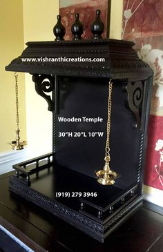table or mounted on the wall. This wooden pooja mandir design is ideal if you have few pictures or idols and would like to use it in a small space. Mandir Decoration, Ganapati Decoration, Decoration For Ganpati, Pooja Room Door Design, Wall Decor Design, Ceiling Design, Ethnic Home Decor, Indian Home Decor, Pooja Mandir Usa