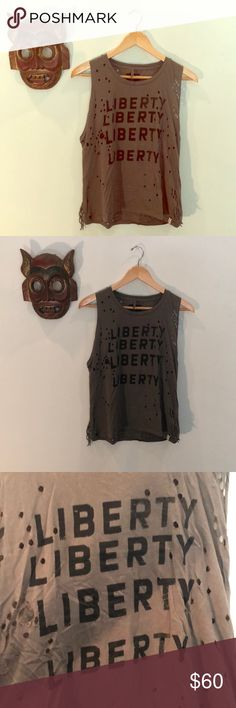 """One Teaspoon Liberty Distressed Muscle Tank Era: Modern  Brand: One Teaspoon Condition: Like New with intentional distressing. Marked Size: XS Fits Like: XS-M Length: 22 Waist: 34 with Stretch Bust: 34 with Stretch Material: Cotton 🖤No trades, no modeling, please make offers via """"offer"""" button. 🖤 One Teaspoon Tops Muscle Tees"""