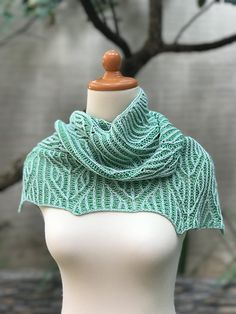 Feeling all the Summer Vibes :: a lightweight, asymmetrical triangle shawl with textural arrow stripes, knit using the two-color brioche stitch. There are two size options for this shawl: Small and Large. They both start the same way, and the pattern repeats are simple and easy to memorize. The Small size is meant to be more of a shawlette, to be worn as an accent to your favorite summer dress. The Large size is perfect to drape around your shoulders or neck on a chilly summer evening.