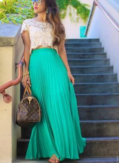 White shirt with aqua/teal skirt