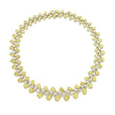 Fine Yellow Diamond and Diamond Necklace Set with eighty-two pear-shaped fancy intense yellow and fancy yellow diamonds together weighing approximately 70.00 carats, decorated by eighty-two marquise-shaped diamonds together weighing approximately 25.20 carats, mounted in platinum, length approximately 410mm.