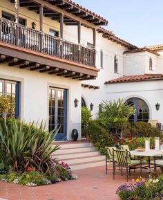 Spanish style house copper accents tile roof light for Spanish colonial exterior paint colors