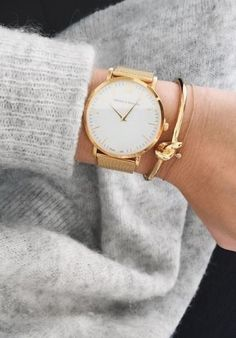 A minimal gold watch is the perfect metallic accent.