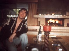 Drummer Keith Moon of the rock and roll band 'The Who' poses for a portrait session at home in November 1974