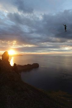 Alexander Schulz slacklines into the sunset.