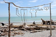 They used driftwood to make clothes outlines. I like the creative-ness of this image.
