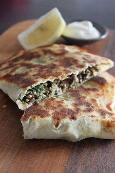 food on paper: Lamb, Spinach and Feta Gozleme. Reminds me of the meat pockets my Grandma's Pakistani friend used to make for us. I should track that recipe down. They were delicious! Turkish Recipes, Lebanese Recipes, Greek Recipes, Indian Food Recipes, Light Recipes, Ethnic Recipes, Lamb Recipes, Gourmet Recipes, Cooking Recipes