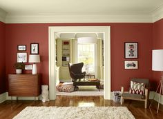 Benjamin Moore Paint Colors - Red Living Room Ideas - Classic Red Living Room - Paint Color Schemes . . . . . Burnt Tucson Red (1300) and a rich cream perfectly complement rich wood furnishings. . . . . . Walls (1st room) - Tucson Red (1300); Library Walls (2nd room) - Amulet (AF-365); Ceiling & Trim (both rooms) - Battenberg (AF-70).