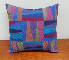 Blue and Purple Patchwork Quilted Pillow. $110.00, via Etsy.
