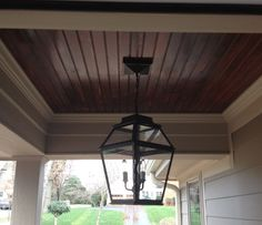 I need to revamp my front porch. Wood slats and some pendant lighting.