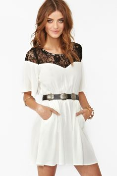 "London Lace Dress - Flowy white dress featuring black lace detailing and front pockets. Cutout back with button closure, stretch panel at waist. Unlined. Looks cute worn with a wide-brim hat and ankle boots!    *100% Rayon  *31.5"" length"