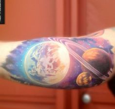 I love the background of this tattoo! I want a space tattoo but I don't want a black background. I think the background colors are so beautiful and galaxy-like and a great alternative to a black background.