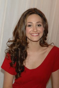 Emmy Rossum Long Curls - Emmy Rossum looked super charming at the Tommy Hilfiger fashion show with her long, bouncy curls.
