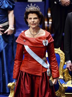 Queen Silvia of Sweden in red gown at the Nobel prize ceremony 10 December 2015.