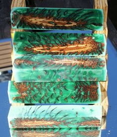 forest green pen blanks with pine cones embedded in alumilite resin by santaericsblanks on Etsy