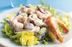 This fruity prawn cocktail recipe is a twist on a very old favourite. You'll only need to spend 10 minutes in the kitchen to make this dish, and once the chunks of juicy prawn, crunchy celery and sweet apple and grape are assembled, it makes a delicious light lunch or starter for a seasonal dinner with friends and family - at just 130 calories per serving.