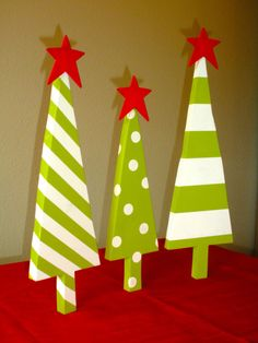 Three Painted Wooden Christmas Trees by DawningDesign on Etsy, $24.99