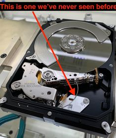 Customer checked in a Western Digital 3TB drive that was losing connection. We powered on the drive and it is making VERY unusual sounds. I am 90% sure the issue with the drive is mechanical and very serious. We opened up the drive cover and this is what we saw. We have seen thousands of drives and this part that's in here is not a part of the drive. The drive cover was opened by someone else and we had no idea. Please understand that we are doctors for hard drives.