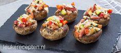 Gevulde champignons met spekjes recept - Hapjes - Eten Gerechten - Recepten Vandaag
