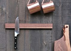 We adore this magnetic knife holder. I have the Teak one in my kitchen.  http://odengallery.com/see-all/decor-tableware/knife-holder-2/ $114 CND