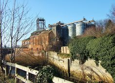 Grain Silos and Supporting Structures -  South Quay, King's Lynn. Norfolk. Located along the South Quay and Millfleet, these imposing structures are now unfortunately no longer in existence. A site which was once a joy to walk around and which spoke of its relationship with the shipping industry and the adjacent 'Great Ouse'. Photograph taken in 2006. Grain Silo, Norfolk, Monument Valley, Photograph, Relationship, Joy, King, Travel, Image